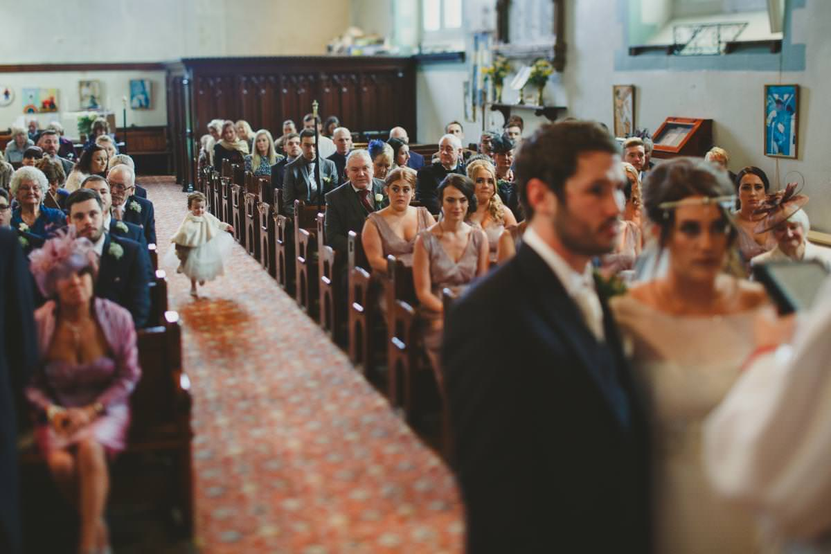Richard Savage Photography - Church wedding, church ceremony, flower girl, real wedding moments, documentary wedding photography, running down the aisle,